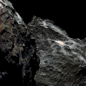 The black surface of Rosetta's comet