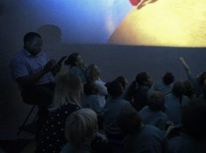 Watching a fulldome film at Sulivan Primary School in London