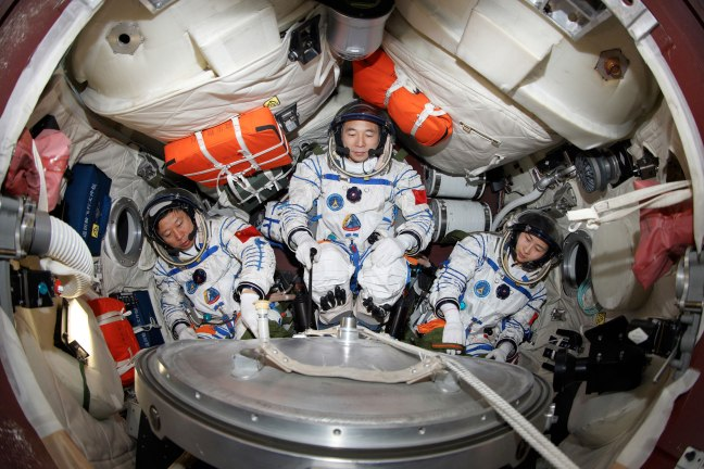 The crew of Shenzhou-9 inside their capsule