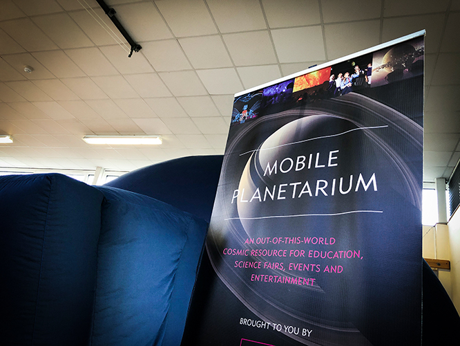Mobile planetarium with banner