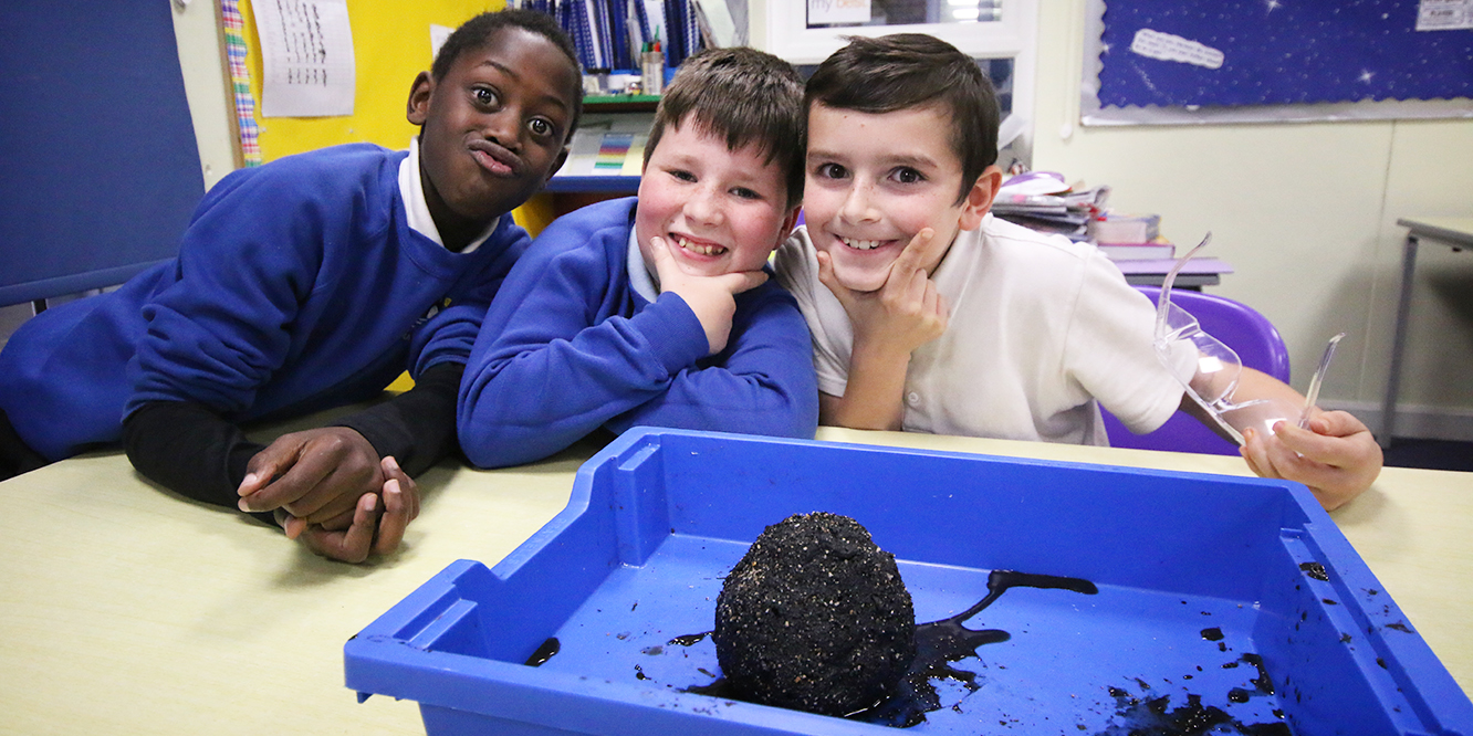 School boys with their comet in a how to cook a comet workshop