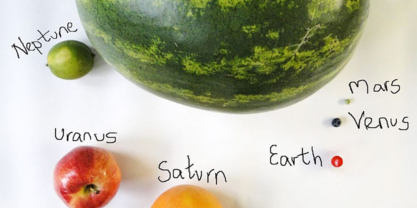 A selection of fruit representing planets in the eat the solar system workshop